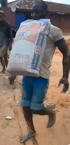 Man carries bag of cement with teeth, wins #100,000 bet.