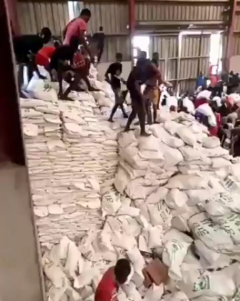 Stacked cartons of perishable goods, bags of food, and cartons of Covid-19 palliative were stacked away at the warehouse in Amuwo Odofin...while people went hungry during the Pandemic lockdown.
