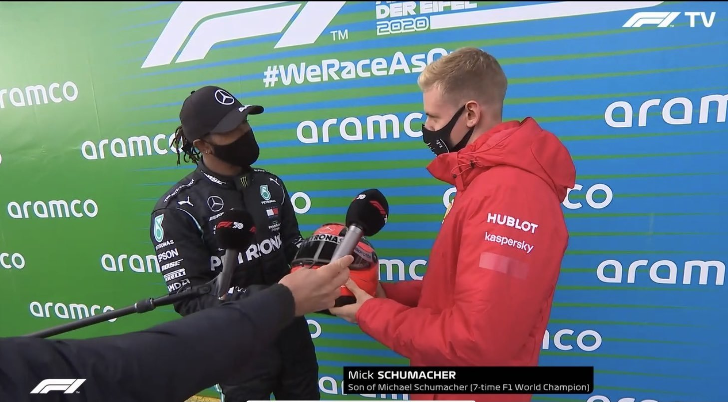 Breaking: Lewis Hamilton equals Michael Schumacher record with #EifelGP F1 Win, gets honored with helmet presented by Mick Schumacher.