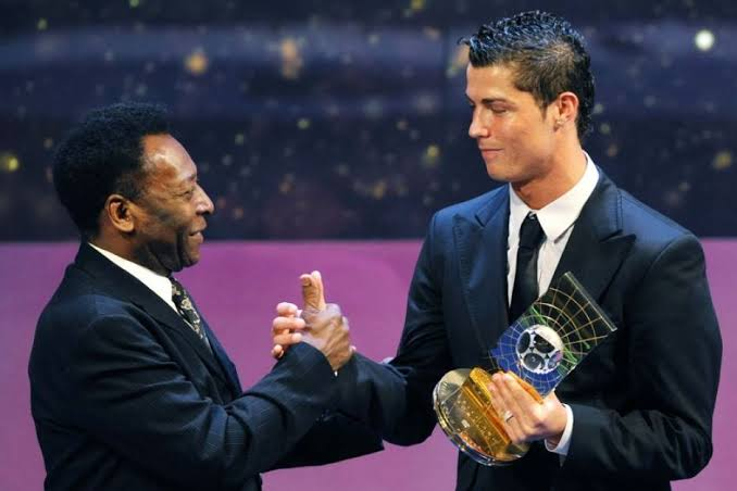 Cristiano Ronaldo celebrates Pele after hitting his 770th official goal