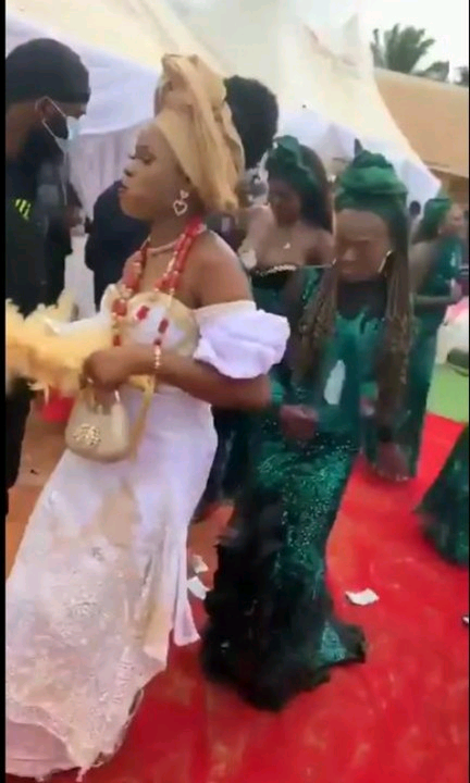 Busty Bridesmaid steals Bride's shine, receives money on breasts at Wedding (Video)
